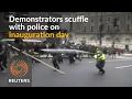 Anti-Trump protesters scuffle with police