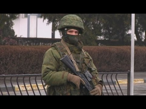 Ukraine crisis: 'Russian forces' seize airports in Crimea region