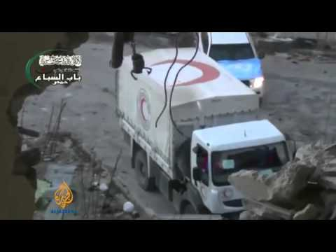 Aid convoy to Syria's Homs comes under attack