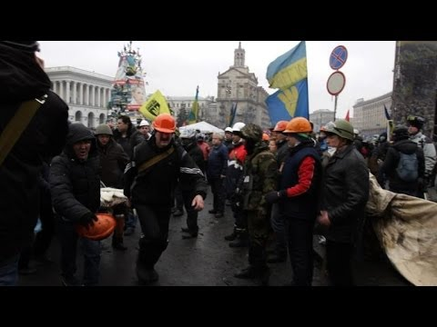Dozens dead in Ukraine as EU imposes sanctions