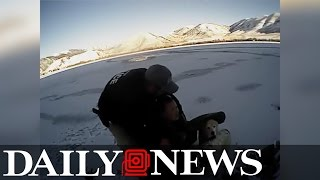 Cops save woman in frozen lake- Exclusive