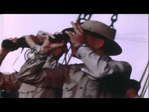 General Julian Smith looks through the binoculars during invasion of Saipan in Ma...HD Stock Footage
