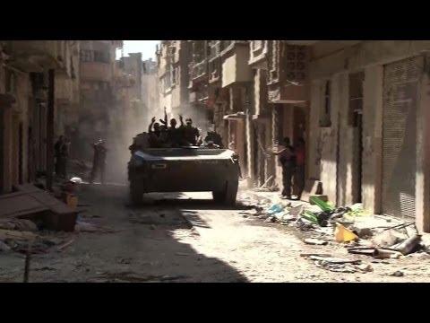 Dutch priest keeps the faith in Syria's besieged Homs