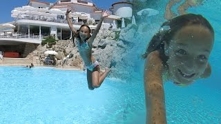 Carla Underwater - swimming in a rocky pool with paddle board