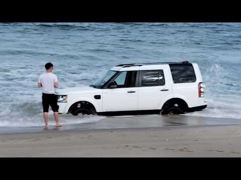Man gets SUV stuck in Jersey Shore surf while taking pictures