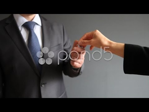 Businesswoman and a businessman exchanging a key for money. Stock Footage