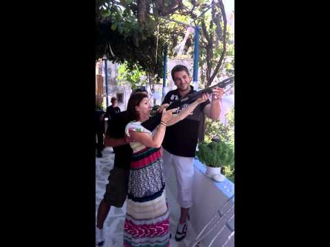 ASPARAMBO GIRL WITH SHOOTGUN AND RAKI - KORONOS / NAXOS
