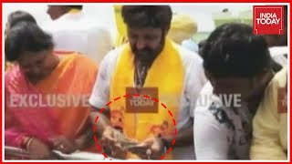 Nandyal By-Polls: Balakrishna slapping a man & distrib..