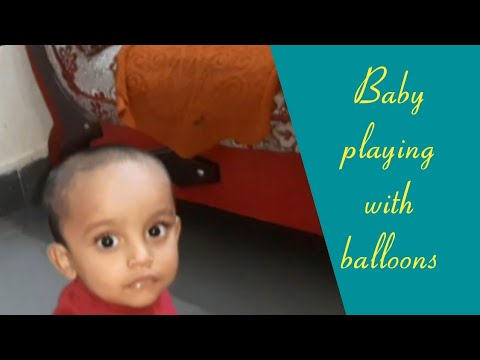 Funny baby playing with balloons 🎈