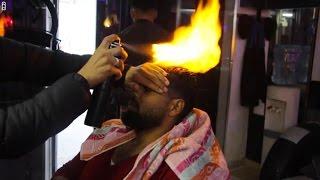 تصفيف الشعر بالنار.. آخر صيحات الحلاقة بغزة |
