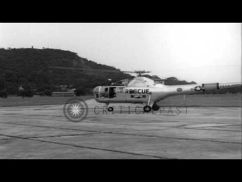 United States Air Rescue Sikorsky H-5 helicopter lifts off in Panama HD Stock Footage