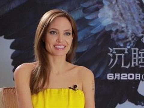 Angelina Jolie Opens Up About Brad Pitt's Red Carpet Run-In With Prankster