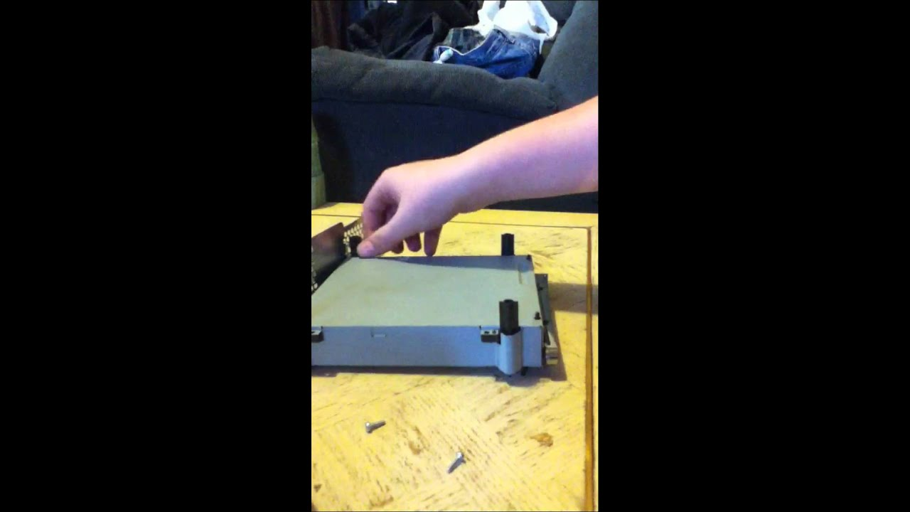 how to take apart xbox 360 slim disk drive