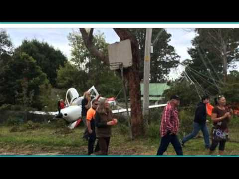 PLANE SURVIVES CRASH AS PARACHUTE DEPLOYS