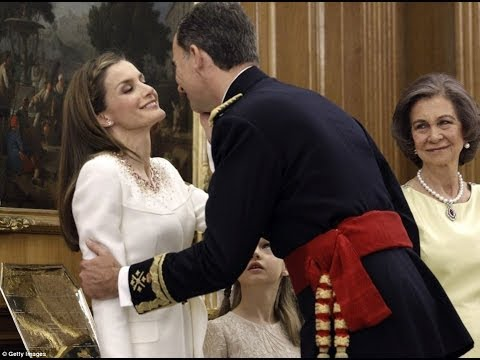 A kiss for my new Queen: King Felipe of Spain takes the crown from a tearful Juan Carlos