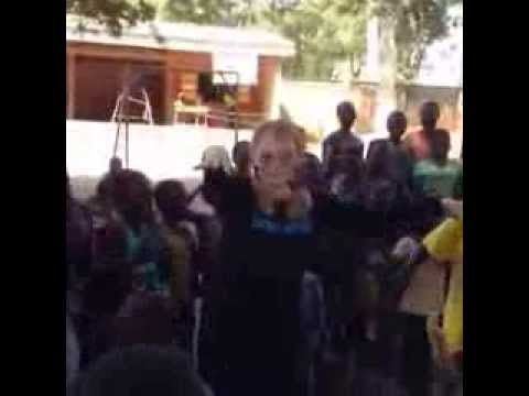 Mia Farrow dance with children displaced by violence in Central African Republic