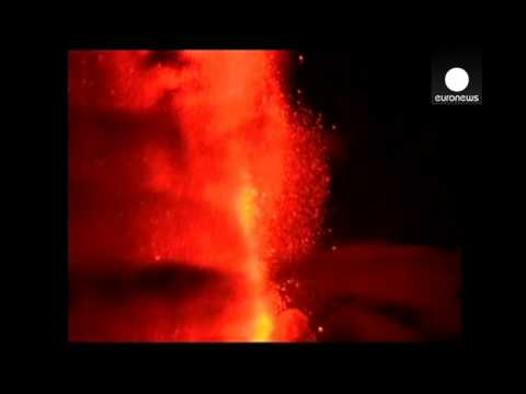 Volcano Villarrica spews lava and incandescent rock, Chile