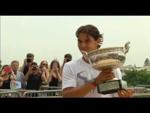 Nadal hoists his ninth French Open trophy before crowd