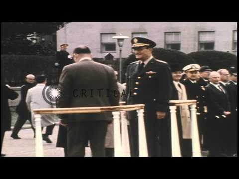 US Defense Secretary Laird takes the salute at the review stand, and talks to sta...HD Stock Footage