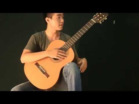 Bài 1: Tư thế cầm đàn và giữ đàn guitar Classic