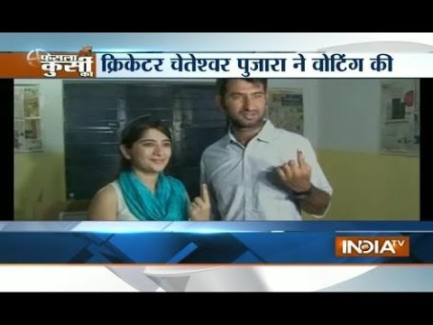 Cricketer Cheteshwar Pujara and his wife casts vote