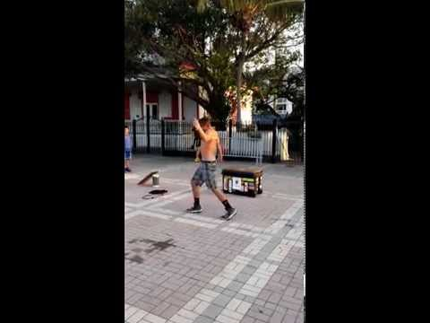 Key West Street Performer Squeezes through Tennis Racket
