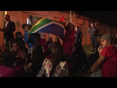 People mourn Mandela outside his Johannesburg home
