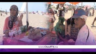 ظروف قاسية لبائعات متجولات على رمال الشاطئ | روبورتاج