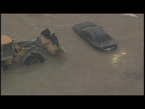 Truck resuces stranded people in water main break