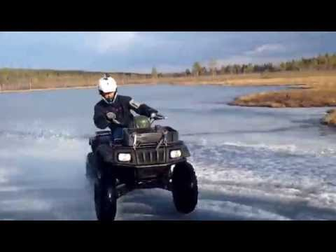 Arctic cat atv on Ice,water and sand!