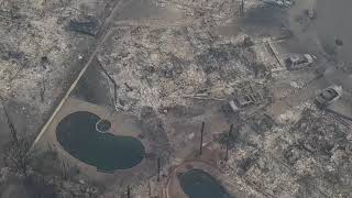 Drone footage shows neighborhood in ashes after California wildfires