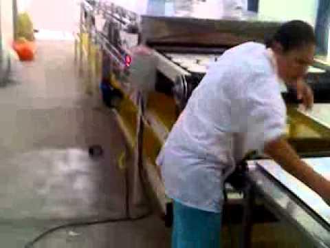 www.Tecnimolinos.com Video de laminadora y horno asador de arepas