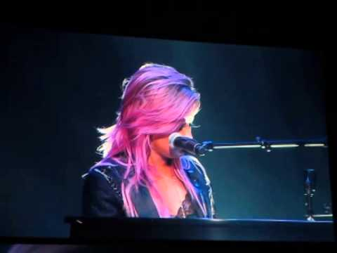 Demi Lovato talking to the crowd and singing Warrior