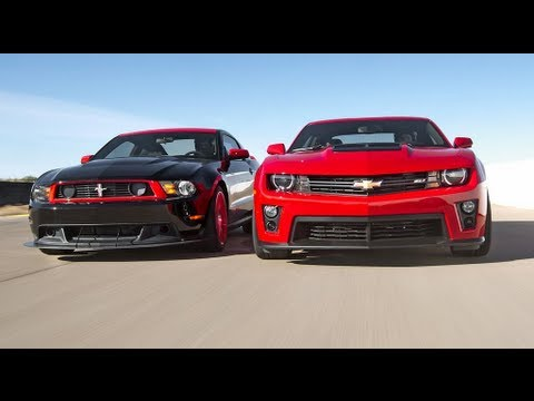 Chevrolet Camaro ZL1 vs Ford Mustang Boss 302 Laguna Seca! - Head 2 Head Episode 3, On this episode of Head 2 Head, Chevrolet's new 2012 Camaro ZL1 faces off against the reigning champion of the pony cars, Ford's 2012 Boss 302 Laguna Seca Ed...