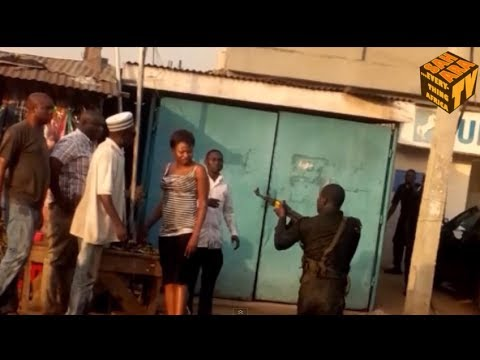 Drunk Nigerian Policeman Assaults Civilians