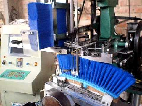 Maquina Insertadora de escobas / broom machine