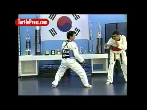 Taekwondo Sparring: How to Score with Rear Leg Jumping Roundhouse Kick