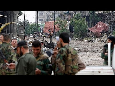 Syrian forces retake control of Homs as rebels exit