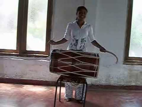 hasini playing the bhangra dhol