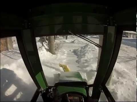 John Deere 345 with Cab and 42 inch Snow Thrower.mp4