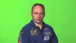 Astronaut Mike Fincke in front of a green screen