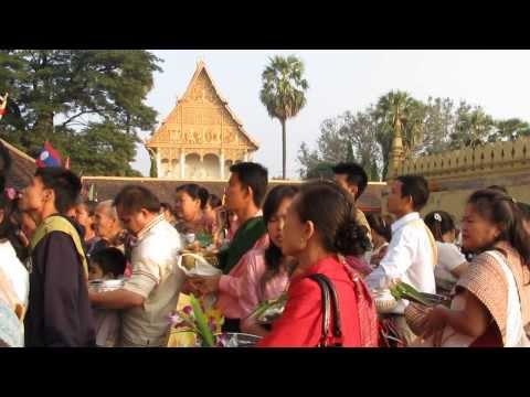 Almsgiving at That Luang Festival