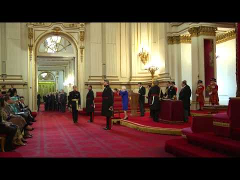 Bradley Wiggins is knighted by The Queen