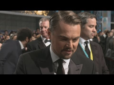 BAFTAs 2014: Leonardo DiCaprio laughs at chanting fans on the red carpet in London