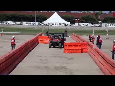 NASA Jet Propulsion Lab Robosimian robot drives car at DARPA Robotics Challenge