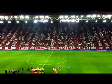 sportstonoto.gr | Olympiacos vs Manchester United: teams entering pitch and fans' coreo