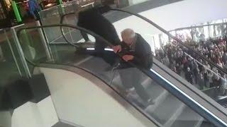 Viral Video : Elderly men struggle to the top of an escalator