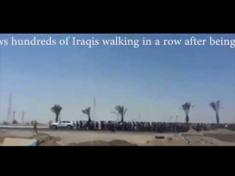 Video shows hundreds of Iraqis walking being captured by ISIL militants Tikrit, Iraq