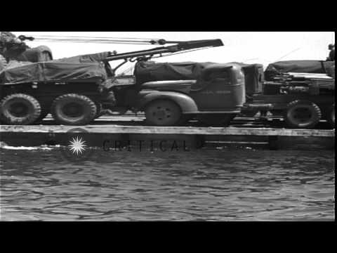 A Rhino barge loaded with army trucks heads for the Utah Beach for the D-Day inva...HD Stock Footage