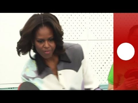 Michelle Obama in China tries hand at ping pong and calligraphy